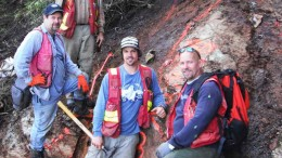 At a fuchsite outcrop on the Snip-Bronson trend at Skyline Gold's Golden Triangle property in Northern British Columbia, from top: Itasca Consulting structural geologist John Fedorowich, CEO John Zbeetnoff, project geologist Brian Janes and COO Jim Sparling. Photo by Skyline Gold