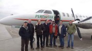 Foran Mining CEO Patrick Soares (third from right) with colleagues including Pierre Lassonde (third from left) and David Harquail (fourth from left) at the airport in Winnipeg, Manitoba. Photo by Foran Mining