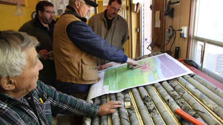 Geologists and consultants discuss the copper orebody at VMS Ventures' Reed project, 50 km west of Snow Lake, Manitoba. Photo by VMS Ventures
