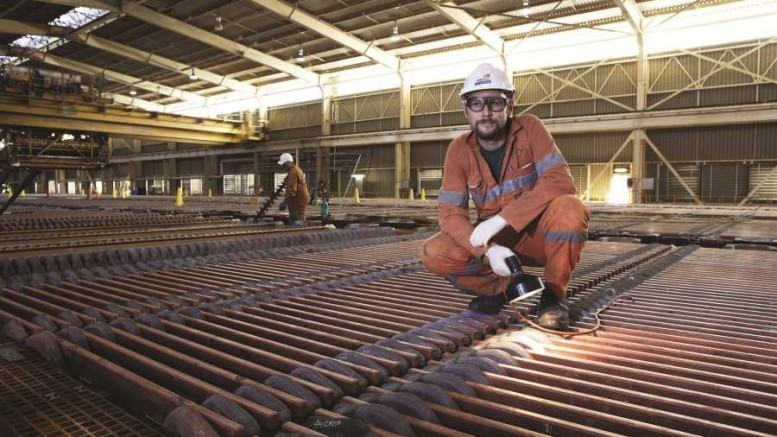 Examining cathode at BHP Billiton's Olympic Dam copper-uranium-gold mine and mill in South Australia. Photo by BHP Billiton