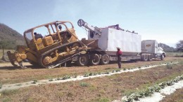 A drill rig and bulldozer arrive at Riverside Resources and Cliffs Natural Resources' Huerta project in Jalisco, Mexico. Photo by Riverside Resources