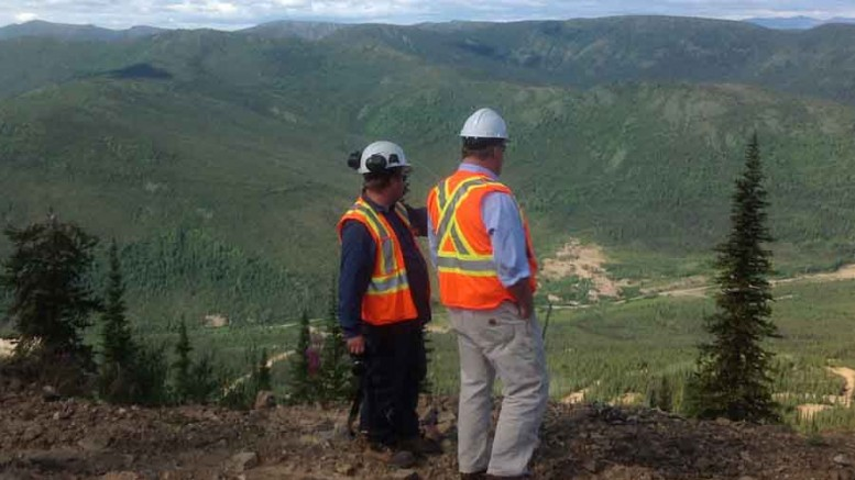 Victoria Gold VP of exploration Rich Eliason (right) and a colleague look over Haggart Creek and the exploration camp at the Dublin Gulch gold project in the Yukon. Photo by Matthew Keevil