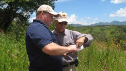 Soltoro CEO Andrew Thomson (left) and an investor look at a map at the El Rayo silver project in Mexico. Photo by Trish Saywell