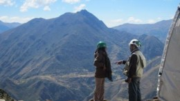 The company's manager of community relations Karina Yavar (left) talks to a geologist at the Bob 1 camp site in Peru.