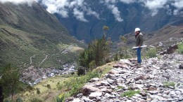 An eastward view towards the Minapampa orebody (centre, in flat, grassy area) at Minera IRL's Ollachea gold project in late 2011. Artisanal miners' structures can be seen at the valley bottom, and hidden even deeper in the valley in the distance is the village of Ollachea. The tunnel portal is in the adjacent valley to the left. Photo by John Cumming