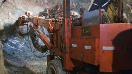 A worker operates a two boom jumbo drill in the Hinge Mine at San Gold's Rice Lake gold mining complex 250 km northeast of Winnipeg, Manitoba. Source: San Gold