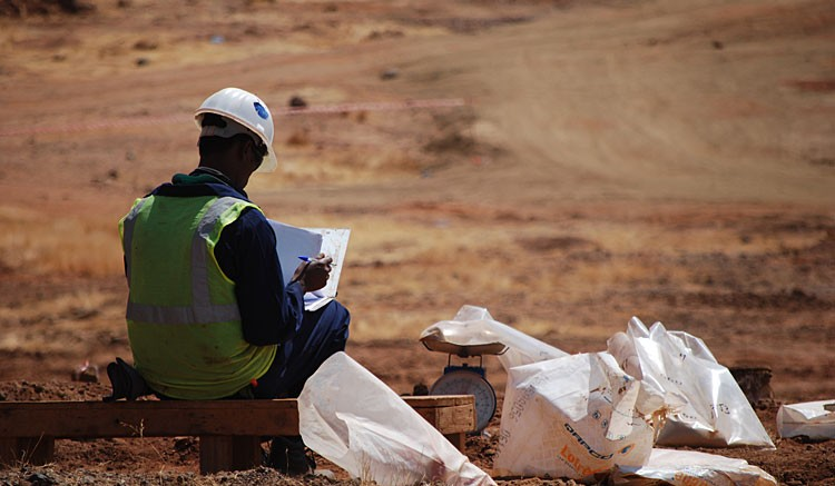 An Eritrean worker labels bags of reverse circulation drill chips at Nevsun's  Bisha mine. Photo by Gwen Preston