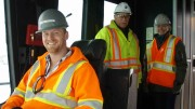 In the cab of an electric shovel at Thompson Creek Metals' Mount Milligan copper-gold project in British Columbia, from left: mine operations general foreman Chris Taylor, construction manager Bert Jeffries and director of corporate responsibility Jocelyn Fraser. Photo by Gwen Preston