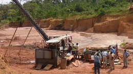 Workers set up equipment at PMI's Obotan project in Ghana. Source: PMI Gold