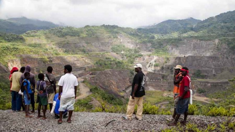 Locals survey the past-producing Panguna copper-gold open pit mine in Bougainville, Papua New Guinea. Photo by Ian Bickis
