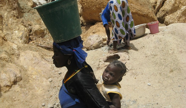 A woman working at Riverstone Resources' (now TrueGold) Karma project in Burkina Faso. Source:  Riverstone Resources