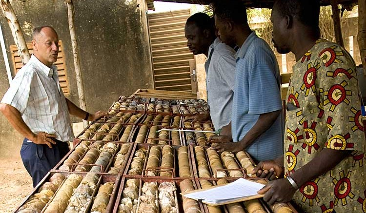 Geologists study drill core at Endeavour's Hound project in  Burkina Faso. Source: Endeavour Mining