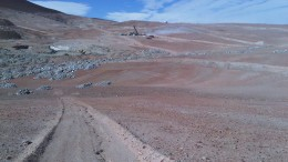 A drill rig in the a distance at Coro Mining's Berta copper project in Chile. Source: Coro Mining