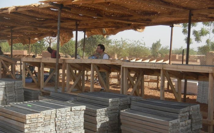 True Gold Mining's chief geologist Chris Lee (centre) examining drill core at the company's facilities near Ouahigouya, Burkina Faso. Source: True Gold Mining
