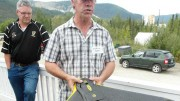 GroundTruth Exploration president Shawn Ryan holds an exploration drone in Dawson City, Yukon, as Taku Gold director Mark Fekete looks on. Photo: Gwen Preston