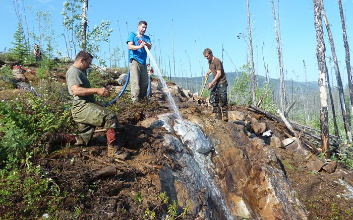 Workers washing a discovery outcrop at Goldstrike Resources' Plateau South gold project in the Yukon. Credit: Goldstrike Resources