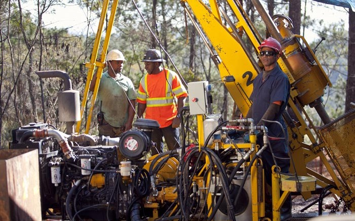 Drillers at Unigold's Neita gold property in the Dominican Republic. Credit: Unigold