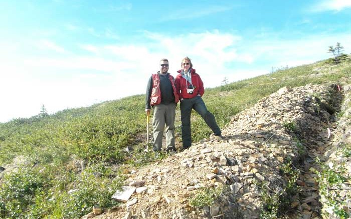 Project geologist Joe Currie and Kaminak Gold president and CEO Eira Thomas stand beside a Supremo zone trench at the Coffee gold project in western Yukon, 130 km south of Dawson City. Photo by Gwen Preston.