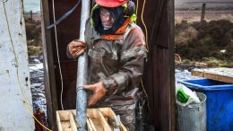 A worker places drill core in a container at Dalradian's Curraghinalt project in Northern Ireland. Credit: Dalradian Resources