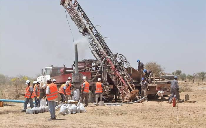 Workers at a drill site at True Gold Mining's Karma gold project in Burkina Faso. Credit: True Gold Mining