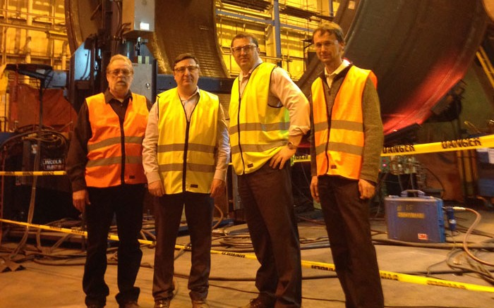 From left: Metso Minerals Canada production manager Andr Bell, Alderon Iron Ore CEO Tayfun Eldem, Alderon COO Brian Penney and Metso manufacturing engineering manager Michel Roy standing in front of a ball mill section to be used at the Kami iron-ore project in the Labrador Trough. Credit: Alderon Iron Ore