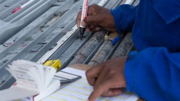 A geo technician checks core sampling at Platinum Group Metals'  Waterberg project on the North Limb of South Africa's prolific Bushveld Complex.