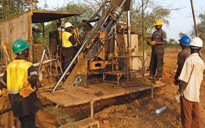 Drillers at Orezone Gold's Bombor gold project in Burkina Faso, where the company is considering a higher-grade heap-leach mining plan. Credit: Orezone Gold