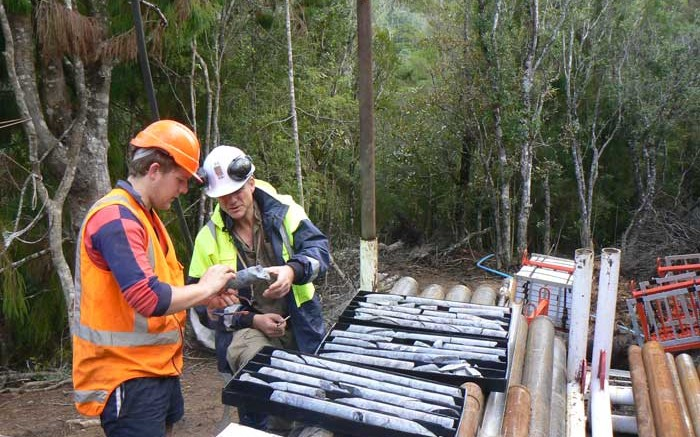 Geologists reviewing core at Antipodes Gold's WKP gold project in New Zealand. Credit: Antipodes Gold