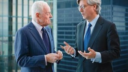A photo showing Peter Munk (left) in discussion with John Thornton (right) taken from Barrick Gold's 2012 Annual Report. Credit: Barrick Gold