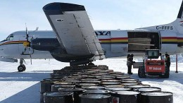 Supplies unloaded from an aircraft on a frozen lake at the Monument Bay property in March 2014. Photo by Anthony Vaccaro.