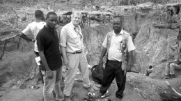 Surrounded by artisanal workings at the Diakha discovery zone at Merrex Gold and Iamgold's Siribaya gold project in Mali, from left (facing the camera): Aboubacar (Eby) Sylla, owner of Touba Mining, a strategic project partner; Greg Isenor, president of Merrex Gold; and Mamadou Diallo, Touba Mining geologist. Credit: Merrex Gold