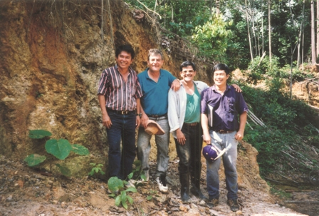 Bre-X Minerals personnel at the Busang property in Indonesia in 1996, from left: Jerry Alo, John Felderhof, Michael de Guzman and Cesar Puspos. Photo by Vivian Danielson of The Northern Miner.