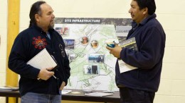 Noront Resources' VP of Aboriginal affairs Glenn Nolan (left) and a local community member discuss proposed infrastructure for the Eagle's Nest nickel-copper-PGM project in Ontario's James Bay Lowlands. Credit: Noront Resources