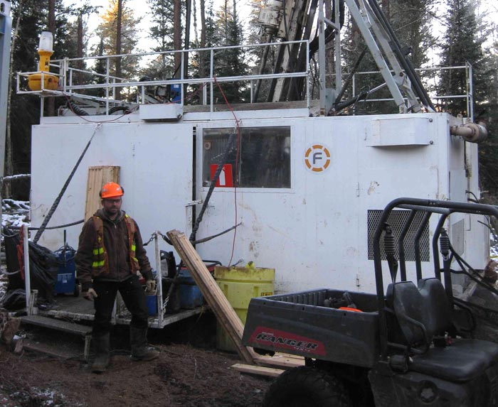 Transition Metals geologist Steve Flank standing in front of the discovery hole at the Sunday Lake PGM project, 25 km north of Thunder Bay, Ontario, in November 2013. Credit: Transition Metals