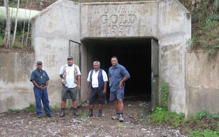 Lion One Metals geological staff in front of the entrance to underground workings at the Tuvatu gold project in Fiji. Credit: Lion One Metals