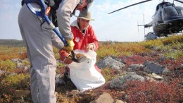 Helicopter pilot Tim Franke (standing) and geologist Bruce Kienlen sample till at Canterra Minerals' diamond project in the Southern Slave region of the Northwest Territories.  Credit: Canterra Minerals