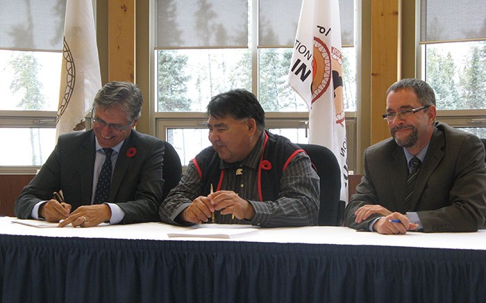 Sealing the deal, from left: Grand Chief Matthew Coon Come, Grand Council of Crees; Chief Matthew Wapachee, Cree Nation of Nemaska; and Guy Bourassa, Nemaska Minerals president and CEO. Photo by Trish Saywell.