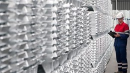 A worker inspects zinc ingots at Nyrstar's Overpelt zinc smelting plant in Belgium. Credit: Nyrstar