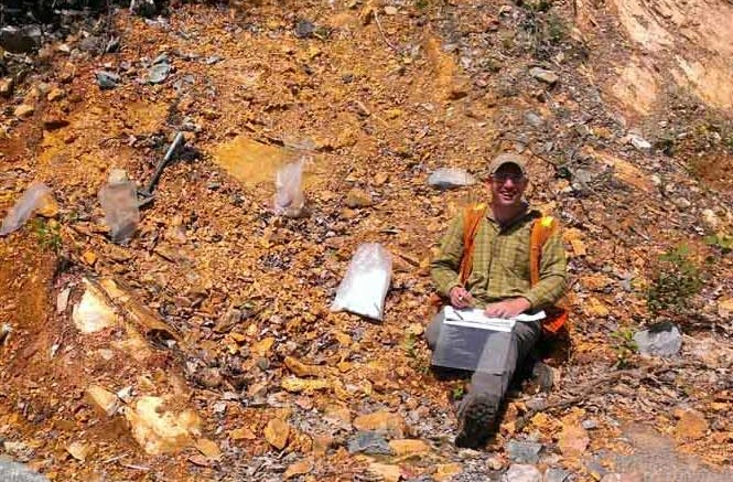 Dave Smith, Wallbridge Mining's JV manager, sampling at the North Range PGM project, where project partner Lonmin has recently invested $1 million for exploration. Credit: Wallbridge Mining