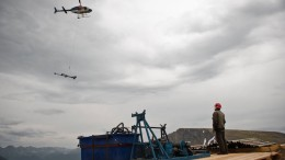 A helicopter drops off equipment to a drill platform at Tower Resources' JD project in B.C. Credit: Tower Resources