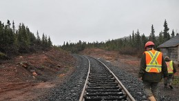 Workers near a railway at Labrador Iron Mines' Schefferville iron ore property in the Labrador Trough. Credit: Labrador Iron Mines
