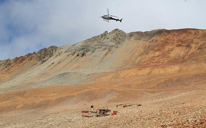 A helicopter delivers supplies at Amarc Resources' IKE copper-moly-silver project in south-central B.C. Credit: Amarc Resources