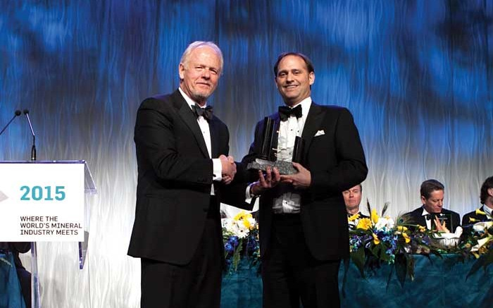 From left: Rod Thomas, president of the PDAC; David Palmer, president and CEO of Probe Mines, and winner of the Bill Dennis Award for a Canadian Discovery or Prospecting Success. Credit: ENVISIONDIGITALPHOTO.COM