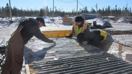 Mega Precious Metals personnel review core samples at the Monument bay gold-tungsten project, 340 km southeast of Thompson, Manitoba. Credit:  Mega Precious Metals