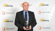 Engineer and Sonic Drilling president Ray Roussy holds his award from the International Mining Hall of Fame. Credit: Sonic Drilling