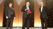 Simon Houlding (middle) accepts the 2015 Vale Medal for Meritorious Contributions to Mining from the Canadian Institute of Mining, Metallurgy and Petroleum in May. Credit: EduMine