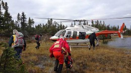 Field personnel approach a landing helicopter near Otter Lake at Paladin Energy's Michelin uranium project, 140 km northeast of Happy Valley-Goose Bay, Newfoundland and Labrador. Source: Paladin Energy