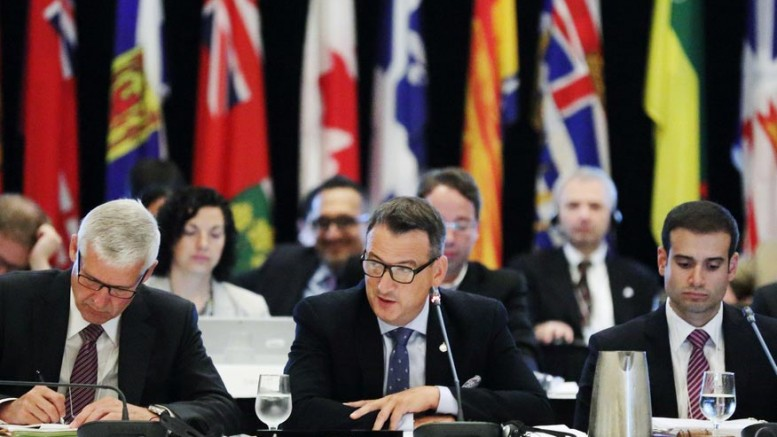 Canada's Minister of Natural Resources GregRickford (centre) at the 2015 Energy and Mines Ministers' Conference in Halifax on July 20. Source: Natural Resources Canada