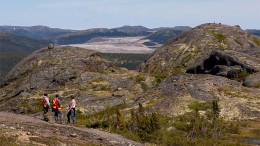 Three geologists look toward the Voisey's Bay  open pit mine. Photo by Joshua Duggan (CC 2.0).