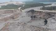 Toxic waste spills out of the tailings dam at Imperial Metals' Mount Polley copper-gold mine, shortly after its collapse in August 2014. Source: